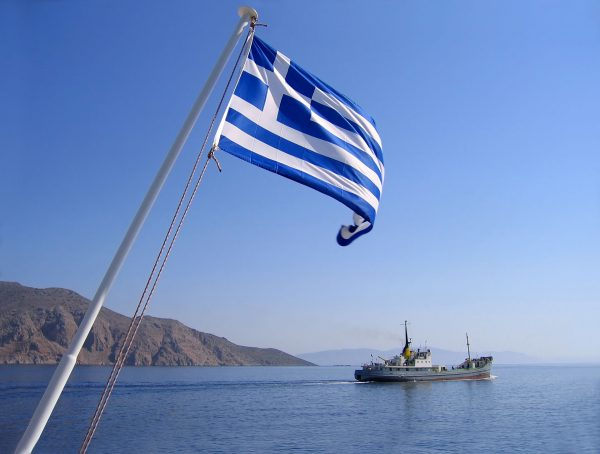 Greece---Flag-and-boat---118367421