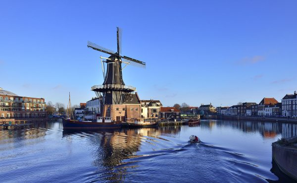 Netherlands---Canal,-windmill-in-Amersterdam---827904314